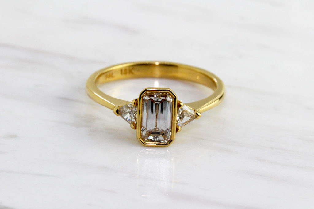 gia certified handmade diamond emerald cut engagement ring in yellow gold by ronan campbell at designyard dublin ireland