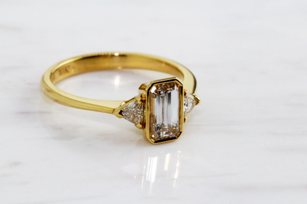 handmade diamond emerald cut engagement ring in yellow gold by ronan campbell at designyard dublin ireland